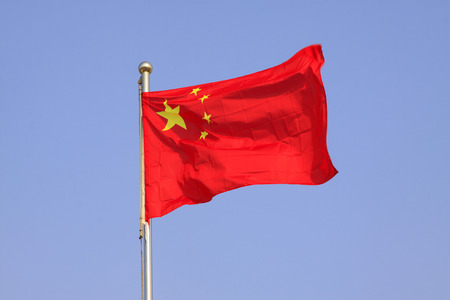 flag of the Republic of China, waving in the blue sky.