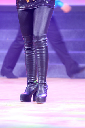 female legs wearing high heeled shoes on the stage Stock Photo