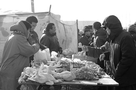 bargaining: LUANNAN COUNTY - JANUARY 28: The customer and vendor in bargaining, before a meat stalls, on january 28, 2014, Luannan county, Hebei province, China.