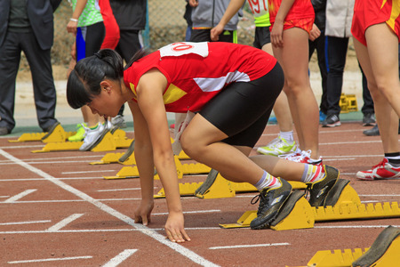 debugging: LUANNAN COUNTY - APRIL 10: Female athletes debugging run up ware on the runway in a school sports meeting, on April 10, 2014, Luannan county, hebei province, China.