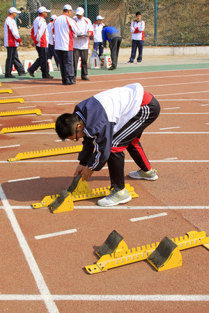 debugging: LUANNAN COUNTY - APRIL 10: referee debugging run up ware on the runway in a school sports meeting, on April 10, 2014, Luannan county, hebei province, China.