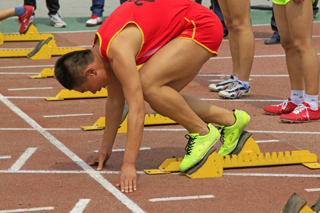 debugging: LUANNAN COUNTY - APRIL 10: sportsman debugging run up ware on the runway in a school sports meeting, on April 10, 2014, Luannan county, hebei province, China.