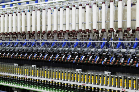 mechanization: Textile spindles on the production line, closeup of photo Stock Photo