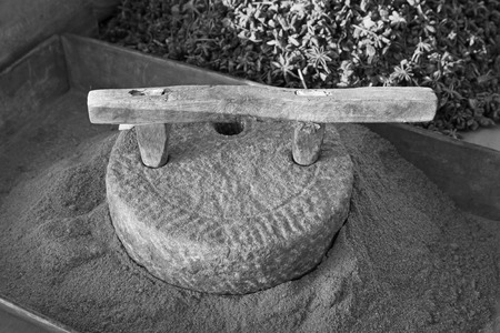 millstone: stone mill in a dressing stall, closeup of photo