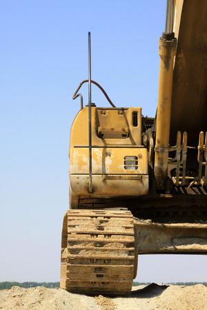 restore ancient ways: Excavator crawler features, closeup of photo Stock Photo
