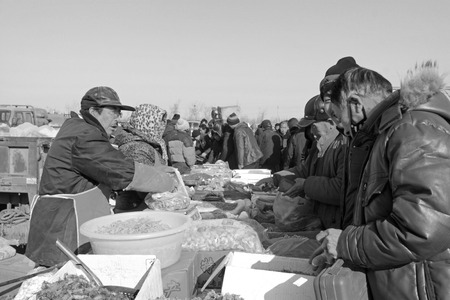 bargaining: LUANNAN COUNTY - JANUARY 28: The customer and vendor in bargaining, before a seafood stalls, on january 28, 2014, Luannan county, Hebei province, China.