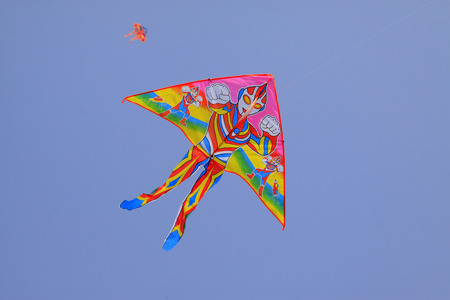 modelling: Cartoon characters modelling kite in the sky Stock Photo