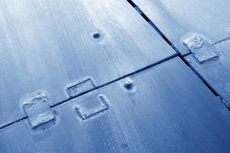 piastra acciaio: patchare su piastra in acciaio, primo piano di fotografia Archivio Fotografico