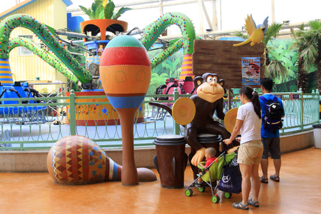 TIANJIN - MAY 17: Visitors are watching cartoon animal model, in the Happy Valley Amusement Park, on May 17, 2014, Tianjin, China.