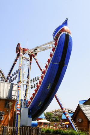 TIANJIN - MAY 17: Large swing rides amusement facilities, Happy Valley, on May 17, 2014, Tianjin, China.   Editorial
