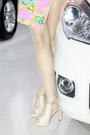 Beauty model dressed in white high heels, closeup of photo photo