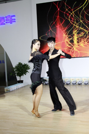latin dance: TANGSHAN - MAY 31: Latin dance performances in a car markets on may 31, 2014, Tangshan city, Hebei Province, China Editorial