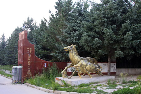 mongolia horse: HEXIGTEN BANNER - JULY 18: benz horse and bull sculpture in the Beijing military area command of the Chinese peoples liberation army Hong Shan Army Horse Ranch, on july 18, 2014, Hexigten Banner, Chifeng city,Inner Mongolia autonomous region, China