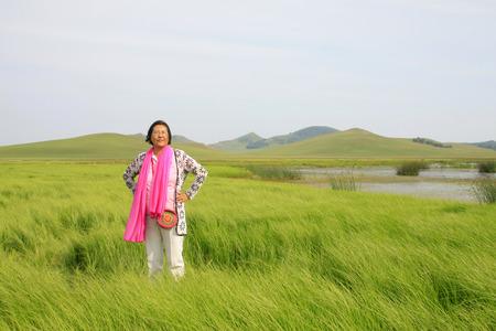 ms: WULANBUTONG GRASSLAND - JULY 18: A female visitors leisure in the WuLanBuTong grassland on July 18, 2014, Inner Mongolia autonomous region, China.