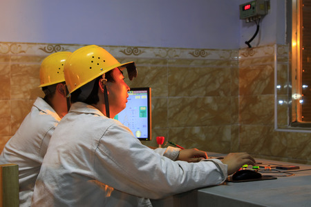 TANGSHAN - JUNE 18: observers in steel plant operation room in a iron and steel co., on June 18, 2014, Tangshan city, Hebei Province, China  Editorial