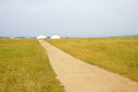 ger: ger and road in the WuLanBuTong grassland, Inner Mongolia autonomous region, China.