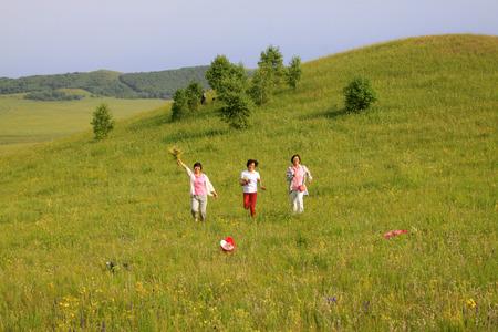 WULANBUTONG GRASSLAND - JULY 18: A few ladies leisure in the WuLanBuTong grassland on July 18, 2014, Inner Mongolia autonomous region, China.