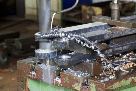 scrap iron: lathe and scrap iron, closeup of photo