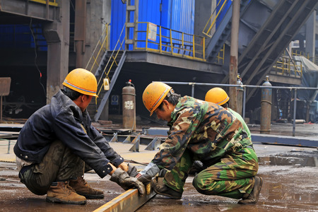 scenarios: TANGSHAN - JUNE 18: Workers in production scenarios in iron and steel co., on June 18, 2014, Tangshan city, Hebei Province, China