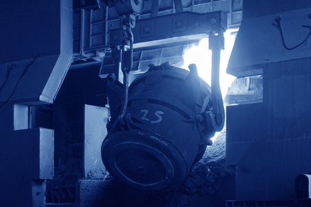 tangshan city: TANGSHAN - JUNE 18: converter filling scrap iron and steel, in a iron and steel co., on June 18, 2014, Tangshan city, Hebei Province, China