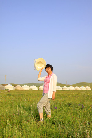 WULANBUTONG GRASSLAND - JULY 18: A female visitors leisure in the WuLanBuTong grassland on July 18, 2014, Inner Mongolia autonomous region, China.