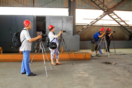 tangshan city: TANGSHAN - JUNE 19: cameramen were filming in a production workshop of iron and steel co., on June 19, 2014, Tangshan city, Hebei Province, China
