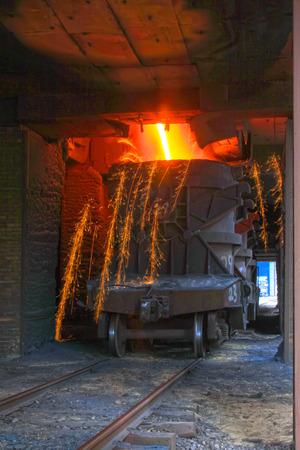 iron works molten iron crucible, closeup of photo photo