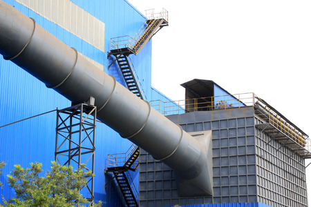 Blue plant and pipeline in a factory, closeup of photo photo