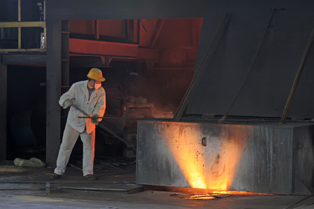 iron works: TANGSHAN - JUNE 19: iron works blast furnace operating workers, on June 19, 2014, Tangshan city, Hebei Province, China  Editorial