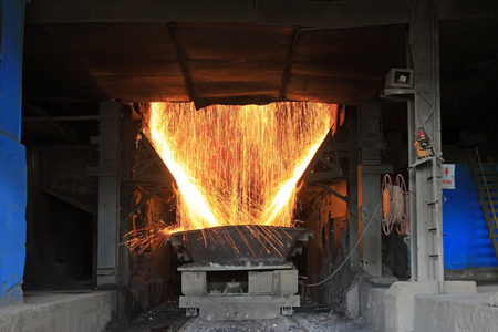 steelmaking converter dumping steel slag in a factory, closeup of photo photo