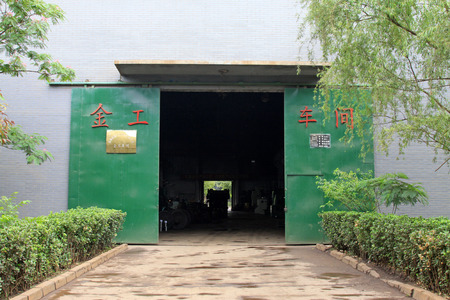 tangshan city: TANGSHAN - JUNE 20: metalworking workshop entrance in a factory, on June 20, 2014, Tangshan city, Hebei Province, China