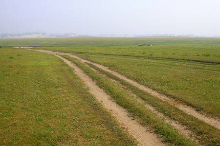 unsurfaced road: unsurfaced road in the WuLanBuTong grassland, Inner Mongolia autonomous region, China. Stock Photo