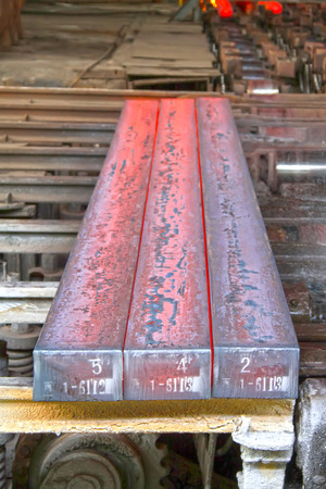 Hot ingot in a steel plant, closeup of photo photo