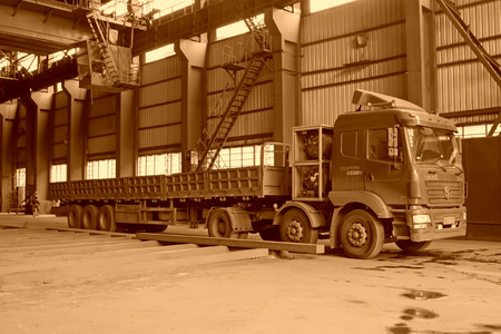 tangshan city: TANGSHAN - JUNE 19: Transport steel ingot heavy truck in iron and steel co., on June 19, 2014, Tangshan city, Hebei Province, China