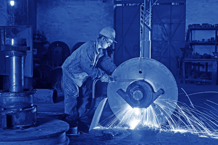 tangshan city: TANGSHAN - JUNE 19: workers welding metal parts in a workshop, on June 19, 2014, Tangshan city, Hebei Province, China