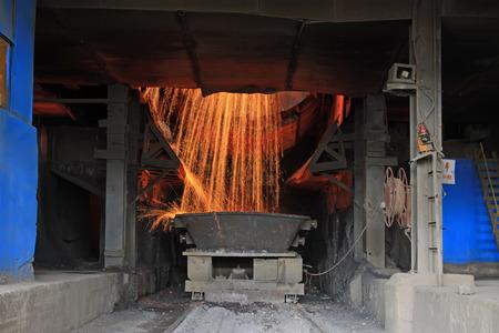 converter: steelmaking converter dumping steel slag in a factory, closeup of photo Stock Photo