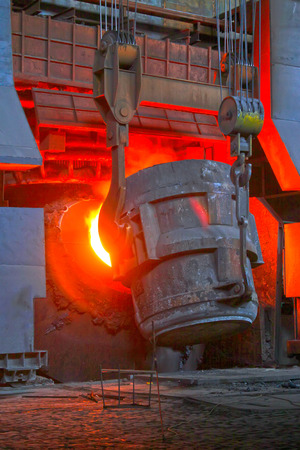 noise pollution: steel mills converter filling materials, closeup of photo