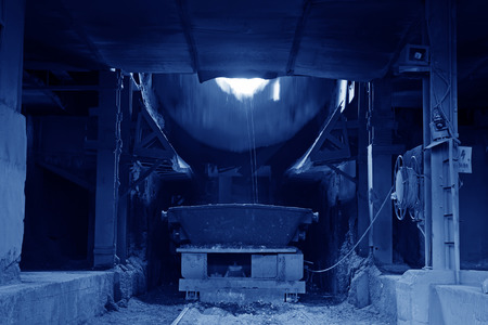 dumping: steelmaking converter dumping steel slag in a factory, closeup of photo Stock Photo