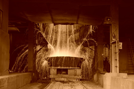 slag: steelmaking converter dumping steel slag in a factory, closeup of photo Stock Photo