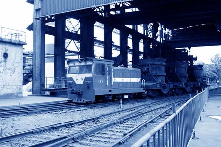 tangshan city: TANGSHAN - JUNE 19: Transportation molten iron crucible train, on June 19, 2014, Tangshan city, Hebei Province, China
