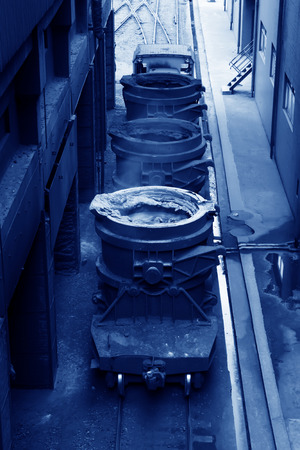 Hot molten iron in the crucible, closeup of photo photo