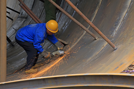 tangshan city: TANGSHAN - JUNE 20: Workers are welding metal components in a steel plant, on June 20, 2014, Tangshan city, Hebei Province, China  Editorial