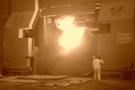 crucible: TANGSHAN - JUNE 19: steel mills converter workers tense work, on June 19, 2014, Tangshan city, Hebei Province, China