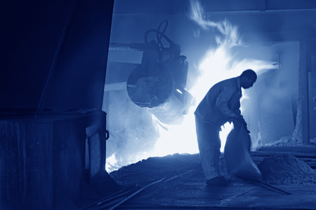tangshan city: TANGSHAN - JUNE 19: iron works blast furnace operating workers, on June 19, 2014, Tangshan city, Hebei Province, China  Editorial