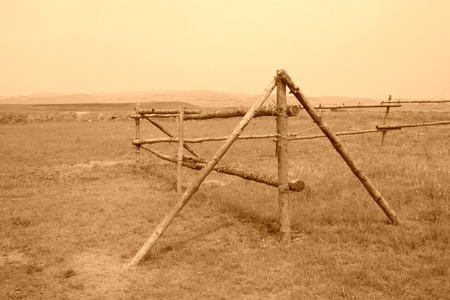 Wooden fence in the grassland  photo