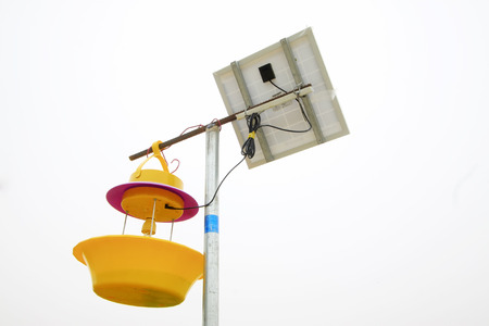 insecticidal: Solar panels and insecticidal lamp, closeup of photo
