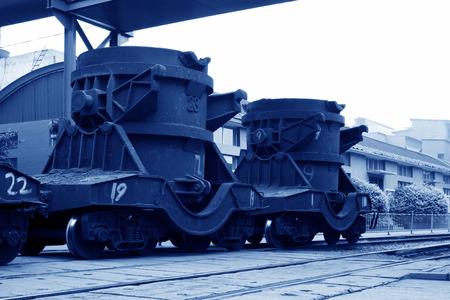 crucible: TANGSHAN - JUNE 20: Transportation molten iron crucible train, on June 20, 2014, Tangshan city, Hebei Province, China
