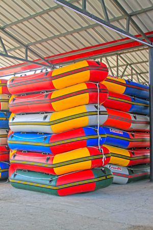 TULIGEN GRASSLAND - JULY 20: inflatable boats heaped in the drifting playground on July 20, 2014, Xilin gol league, Inner Mongolia autonomous region, China.  Editorial