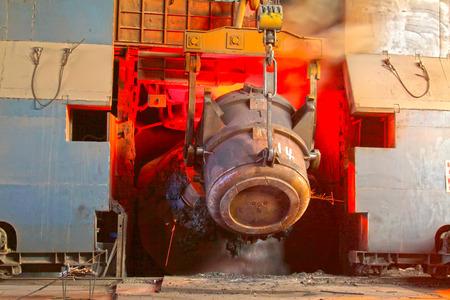 crucible: steel mills converter filling materials, closeup of photo