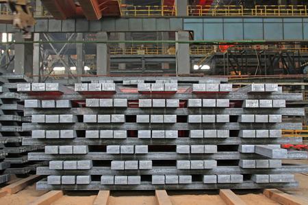 Hot ingot in a steel plant, closeup of photo